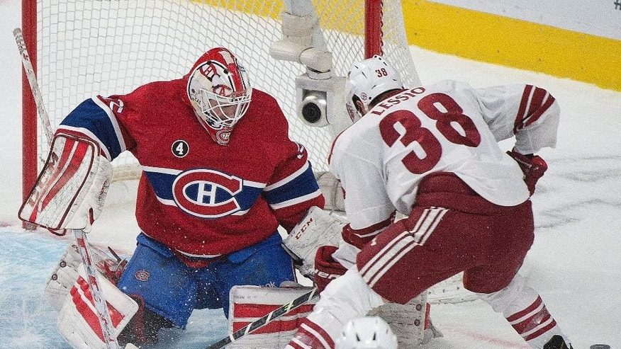 Montreal Canadiens goaltender Dustin Tokarski makes a save on Arizona Coyotes' Lucas Lessio during first period NHL hockey action in Montreal, Sunday, Feb. 1, 2015. (AP Photo/The Canadian Press, Graham Hughes)