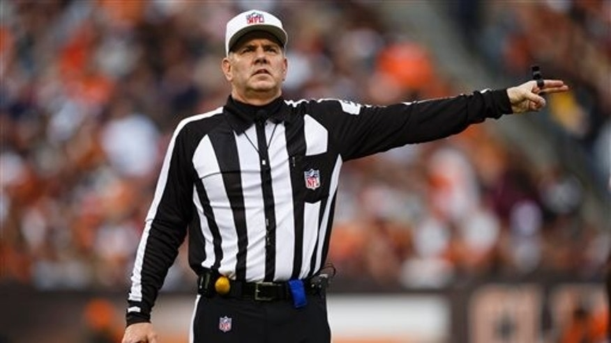 FILE - In this Dec. 16, 2012, file photo, NFL referee Bill Vinovich gestures during an NFL football game between the Cleveland Browns and the Washington Redskins in Cleveland. (AP Photo/Rick Osentoski, File)