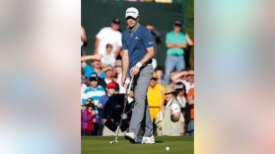Martin Laird reacts after missing a birdie putt that would have put him in a tie for the lead on the 18th hole during the final round of the Phoenix Open golf tournament, Sunday, Feb. 1, 2015, in Scottsdale, Ariz. (AP Photo/Rick Scuteri)