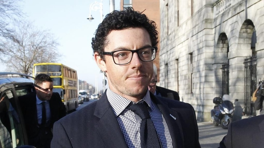 Rory McIlroy arrives at Dublin high court, Ireland, Tuesday Feb. 3, 2015.  The four-time major winner initiated the multi-million dollar case against his former management company claiming he was misled into signing a contract with the company. (AP Photo/Peter Morrison)