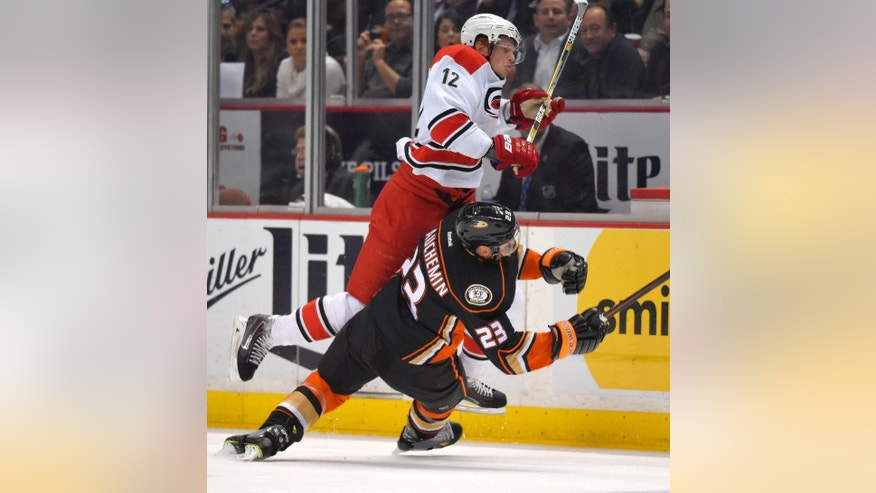 Carolina Hurricanes center Eric Staal, top, and Anaheim Ducks defenseman Francois Beauchemin collide during the first period of an NHL hockey game, Tuesday, Feb. 3, 2015, in Anaheim, Calif. (AP Photo/Mark J. Terrill)