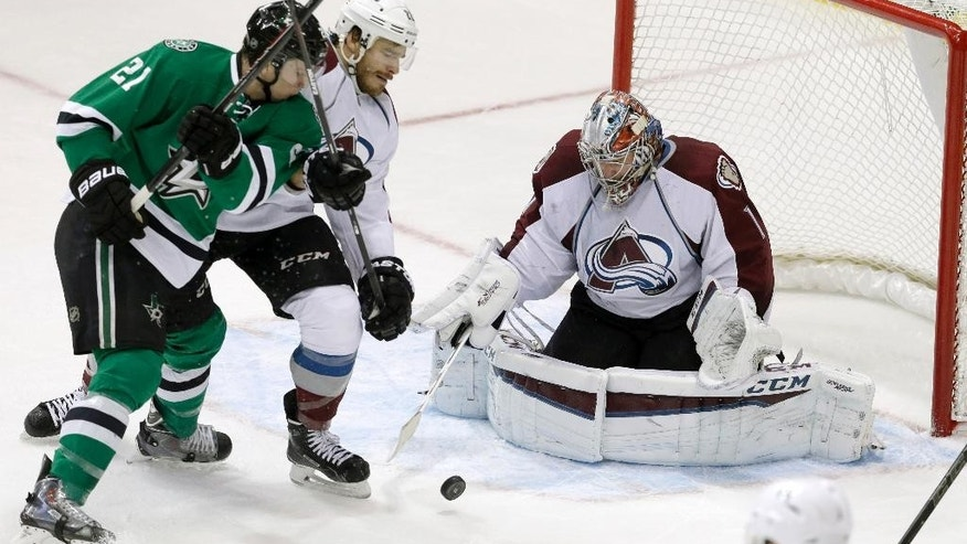Colorado Avalanche goalie Semyon Varlamov (1) and Zach Redmond (22) defend the goal against Dallas Stars left wing Antoine Roussel (21) during the second period of an NHL hockey game Tuesday, Feb. 3, 2015, in Dallas. (AP Photo/LM Otero)