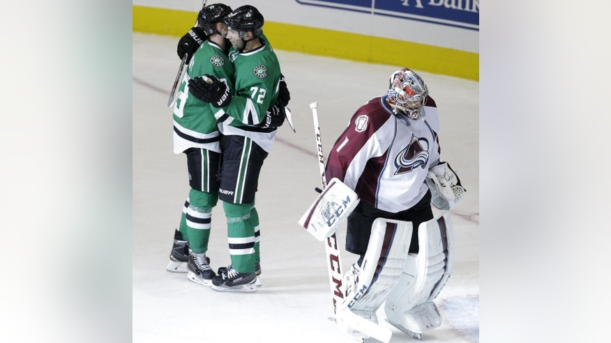 Colorado Avalanche goalie Semyon Varlamov (1) skates away as Dallas Stars right wing Erik Cole (72) celebrates scoring a goal with teammate Ales Hemsky (83) during the second period of an NHL hockey game Tuesday, Feb. 3, 2015, in Dallas. (AP Photo/LM Otero)