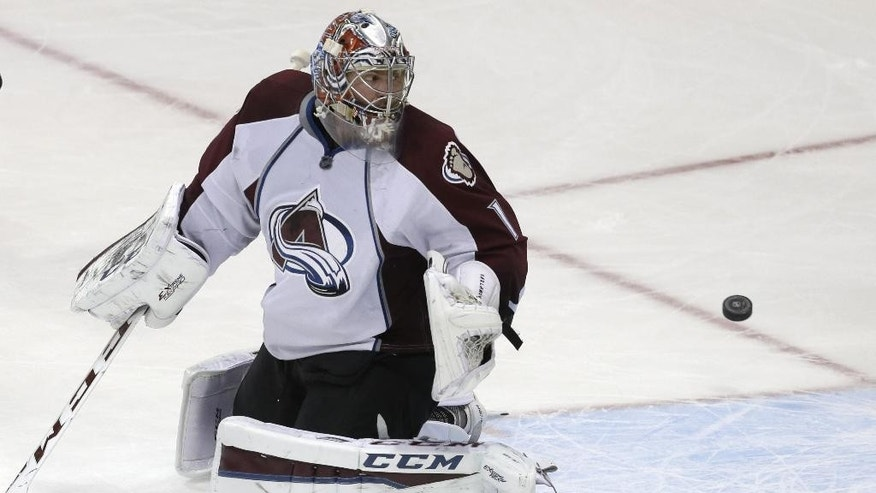 Colorado Avalanche goalie Semyon Varlamov (1) can't stop the puck allowing a goal by Dallas Stars Erik Cole, not shown, during the second period of an NHL hockey game Tuesday, Feb. 3, 2015, in Dallas. (AP Photo/LM Otero)