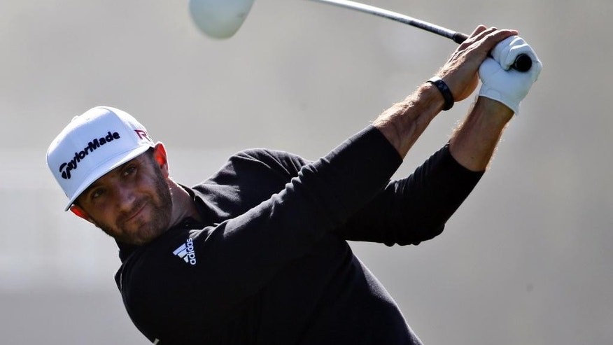 Dustin Johnson tees off on the fourth hole during the pro-am at the Farmer Insurance Open golf tournament at Torrey Pines, Wednesday, Feb. 4, 2015, in San Diego. (AP Photo/Lenny Ignelzi)