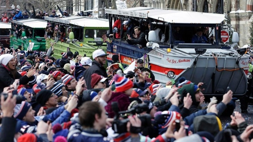 Feb. 4, 2015: New England Patriots fans cheer as the team passes by in a procession of duck boats during a parade in Boston to honor the Patriots' victory over the Seattle Seahawks in Super Bowl XLIX Sunday in Glendale, Ariz. (AP)