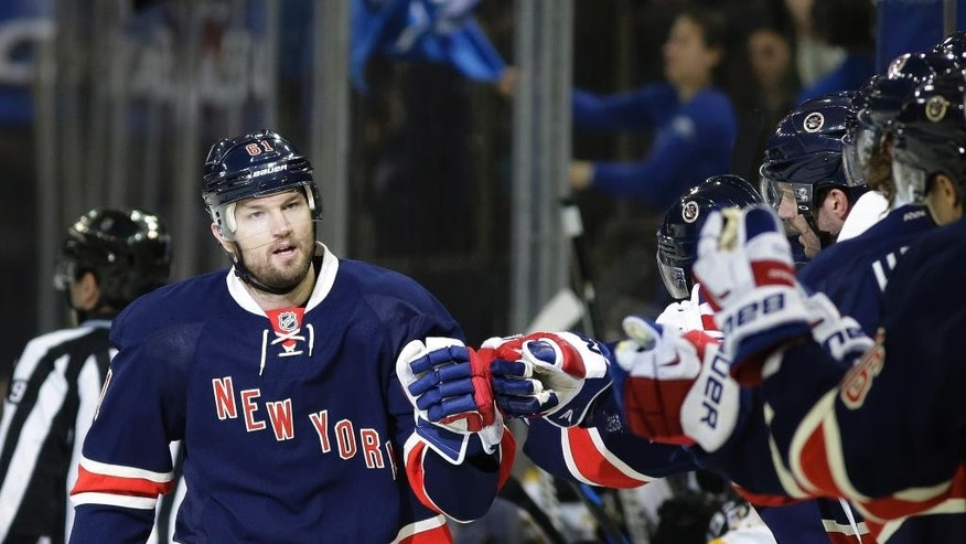New York Rangers left wing Rick Nash (61) greets his teammates after scoring in the first period of an NHL hockey game Boston Bruins at Madison Square Garden in New York, Wednesday, Feb. 4, 2015. (AP Photo/Kathy Willens)