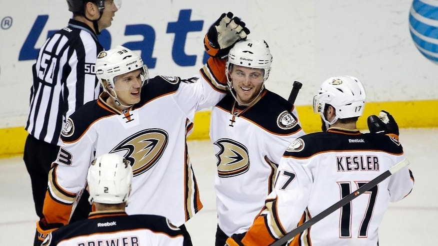 Anaheim Ducks right wing Jakob Silfverberg (33), of Sweden, is congratulated after scoring his second goal of the game against the Nashville Predators in the second period of an NHL hockey game Thursday, Feb. 5, 2015, in Nashville, Tenn. (AP Photo/Mark Humphrey)