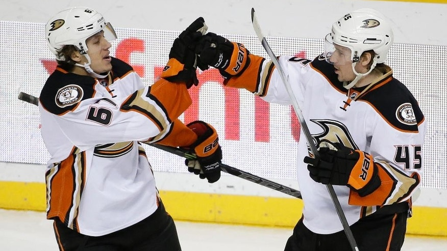 Anaheim Ducks defenseman Sami Vatanen (45), of Finland, is congratulated by Rickard Rakell (67), of Sweden, after Vatanen scored a goal against the Nashville Predators in the first period of an NHL hockey game Thursday, Feb. 5, 2015, in Nashville, Tenn. (AP Photo/Mark Humphrey)