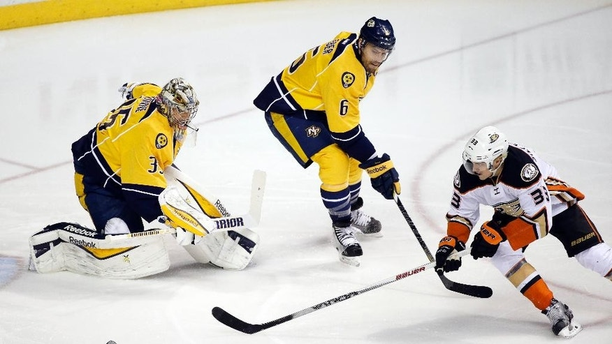 Anaheim Ducks right wing Jakob Silfverberg (33), of Sweden, steals the puck to score a short-handed goal against Nashville Predators goalie Pekka Rinne (35), of Finland, and defenseman Shea Weber (6) in the first period of an NHL hockey game Thursday, Feb. 5, 2015, in Nashville, Tenn. (AP Photo/Mark Humphrey)