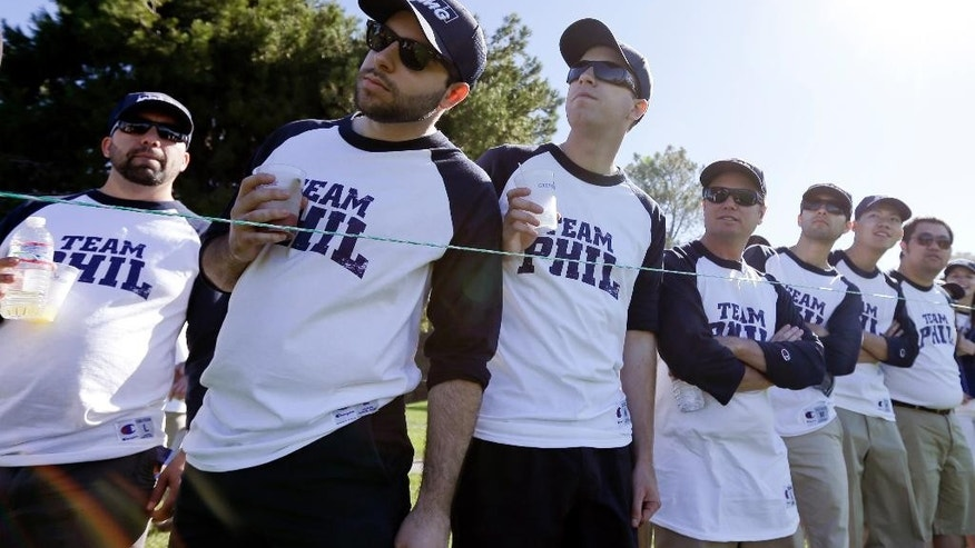 Fans of Phil Mickelson wear matching shirts as they watch Mickelson play on the North Course during the second round of the Farmers Insurance Open golf tournament Friday, Feb. 6, 2015, in San Diego. (AP Photo/Gregory Bull)