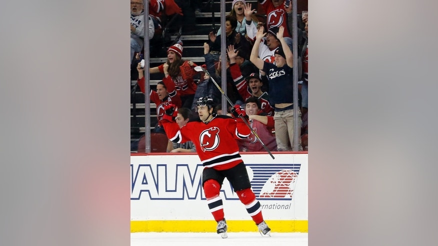 New Jersey Devils left wing Tuomo Ruutu, of Finland, celebrates after scoring a goal against the Toronto Maple Leafs during the first period of an NHL hockey game, Friday, Feb. 6, 2015, in Newark, N.J. (AP Photo/Julio Cortez)