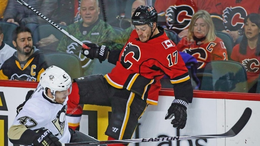 Pittsburgh Penguins Simon Despres, left, checks Calgary Flames Lance Bouma during the first period on an NHL hockey game, Friday, Feb. 6, 2015 in Calgary, Alberta. (AP Photo/Canadian Press, Jeff McIntosh)