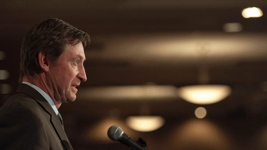 Hockey great Wayne Gretzky speaks during a media event before a tribute to Gordie Howe in Saskatoon, Saskatchewan, Friday, Feb. 6, 2015. (AP Photo/The Canadian Press, Liam Richards)