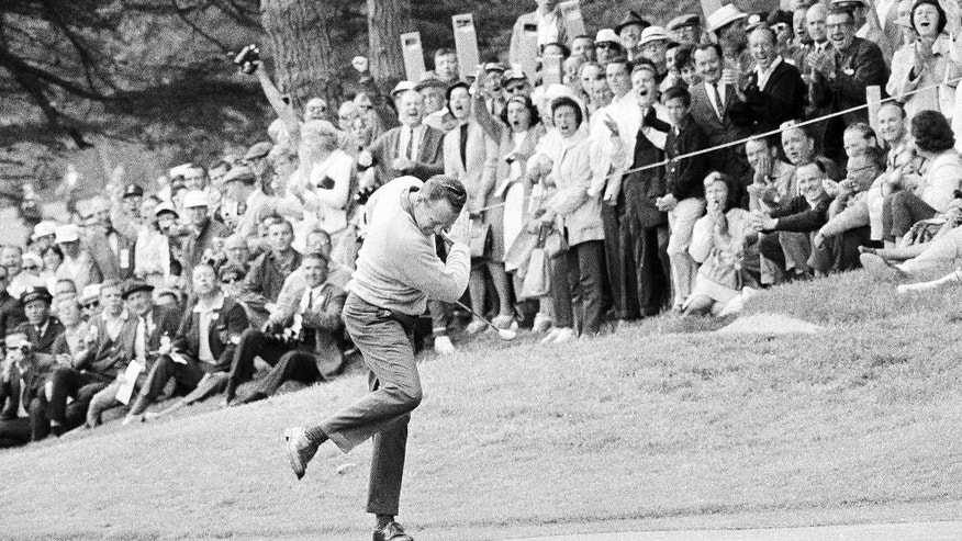 "FILE - In this June 20, 1966, file photo, Billy Casper reacts after running a 25-foot putt into the cup on the 11th green during his playoff with Arnold Palmer for the U.S. Open title in San Francisco. Casper, a prolific winner on the PGA Tour whose career was never fully appreciated in the era of the ""Big Three,"" died Saturday, Feb. 7, 2015, at his home in Utah. He was 83. (AP Photo/File)"
