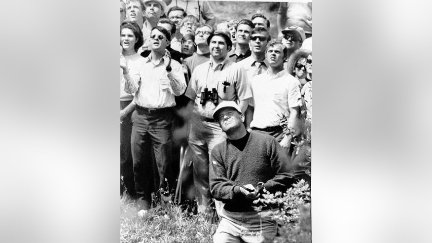 "FILE - In this April 16, 1970, file photo, Billy Casper hit out of a trap during the Masters playoff at Augusta, Ga. Casper, a prolific winner on the PGA Tour whose career was never fully appreciated in the era of the ""Big Three,"" died Saturday, Feb. 7, 2015, at his home in Utah. He was 83. (AP Photo/File)"