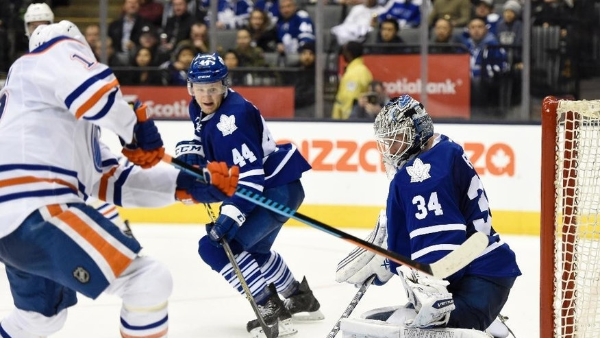 Toronto Maple Leafs goalie James Reimer stops Edmonton Oilers' Nail Yakupov during the third period of an NHL hockey game Saturday, Feb. 7, 2015, in Toronto. (AP Photo/The Canadian Press, Frank Gunn)