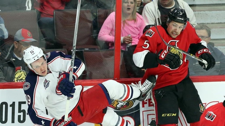 Columbus Blue Jackets' Ryan Johansen (19) is checked by Ottawa Senators' Cody Ceci (5) during the first period on an NHL hockey game, Saturday, Feb. 7, 2015 in Ottawa, Ontario.  (AP Photo/Canadian Press, Fred Chartrand)