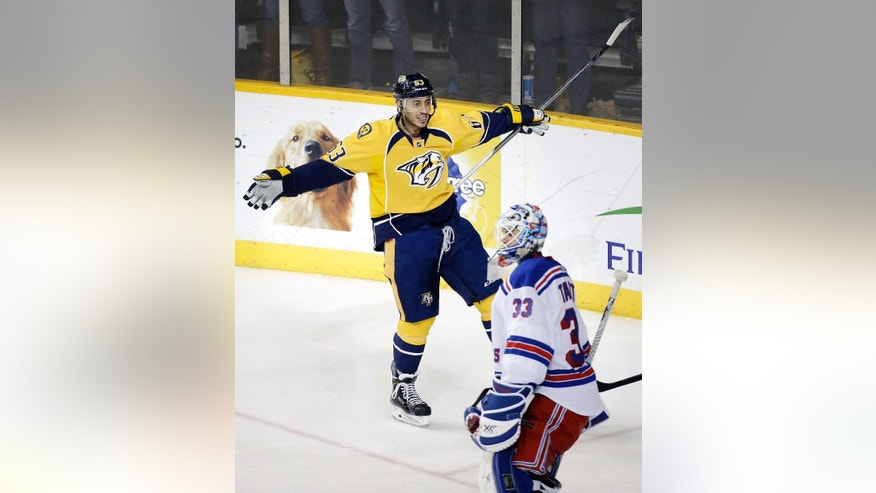 Nashville Predators center Mike Ribeiro (63) celebrates after scoring a goal against New York Rangers goalie Cam Talbot (33)  in the third period of an NHL hockey game Saturday, Feb. 7, 2015, in Nashville, Tenn. (AP Photo/Mark Humphrey)