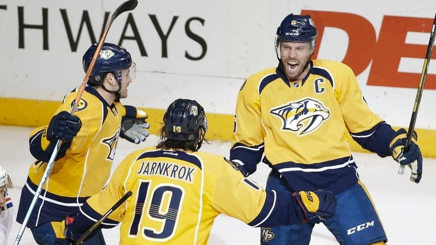 Nashville Predators defenseman Shea Weber, right, celebrates with Calle Jarnkrok (19), of Sweden, and Taylor Beck, left, after Weber scored a goal against the New York Rangers in the second period of an NHL hockey game, Saturday, Feb. 7, 2015, in Nashville, Tenn. (AP Photo/Mark Humphrey)