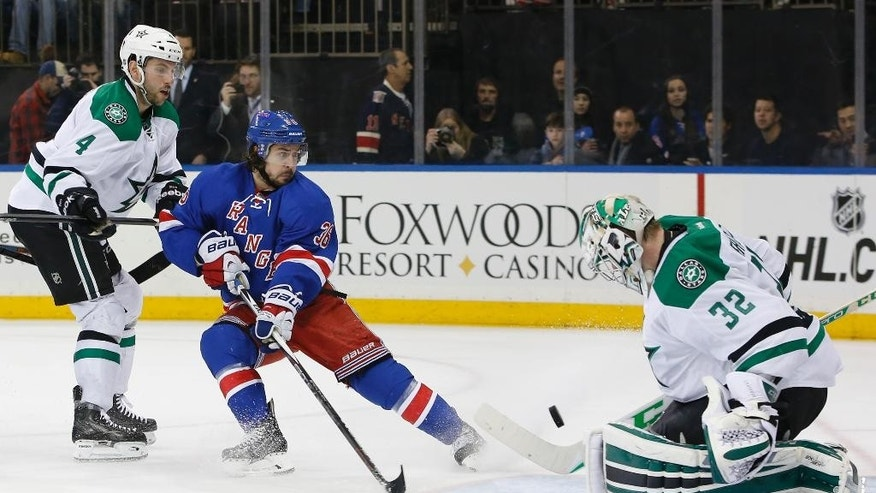 Dallas Stars goalie Kari Lehtonen (32), of Finland, makes a save in front of Stars defenseman Jason Demers (4) and New York Rangers right wing Mats Zuccarello (36), of Norway, in the second period of an NHL hockey game at Madison Square Garden, Sunday, Feb. 8, 2015, in New York. (AP Photo/Kathy Willens)