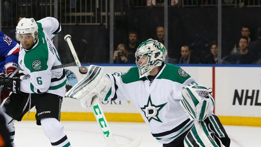 Dallas Stars goalie Kari Lehtonen, right, of Finland, makes a save as Stars defenseman Trevor Daley (6) watches in the second period of an NHL hockey game against the New York Rangers, Sunday, Feb. 8, 2015, at Madison Square Garden in New York. (AP Photo/Kathy Willens)