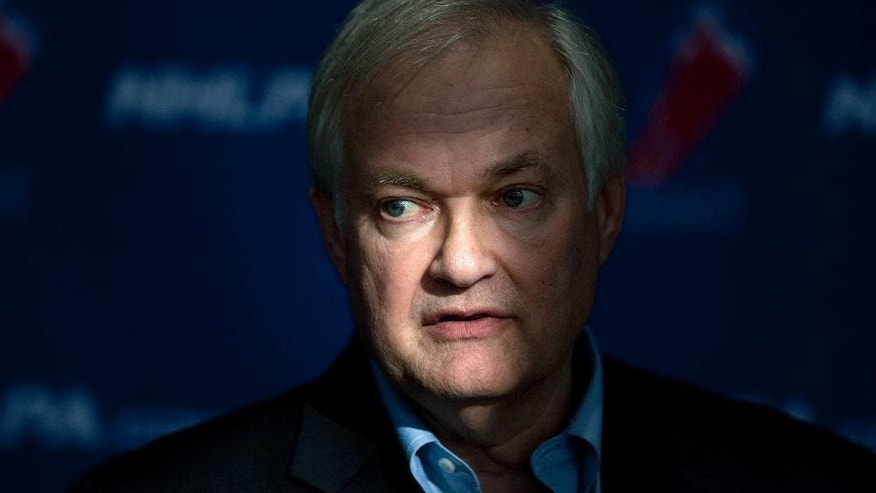 FILE - In a Tuesday, Oct. 16, 2012 file photo, NHL players' association head Donald Fehr speaks to reporters following collective bargaining talks in Toronto. Fehr has brought stability to the NHL Players Association and with it a lenghty stretch of labor peace. Three years after a lockout wiped out nearly half the 2012-13 season, the league and union are working on plans to build the sport. (AP Photo/The Canadian Press, Chris Young, File)
