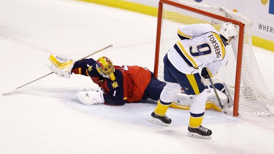 Nashville Predators center Filip Forsberg (9), of Sweden, scores against Florida Panthers goalie Roberto Luongo (1) during the shootout of an NHL hockey game, Sunday, Feb. 8, 2015, in Sunrise, Fla. The Predators defeated the Panthers 3-2. (AP Photo/Wilfredo Lee)