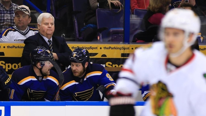 St. Louis Blues head coach Ken Hitchcock watches his team during the first period of an NHL hockey game against the Chicago Blackhawks, Sunday, Feb. 8, 2015, in St. Louis. (AP Photo/Billy Hurst)