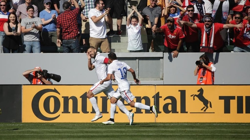 United States' Clint Dempsey, center left, and Miguel Ibarra celebrate a goal by Dempsey during the first half of a friendly soccer match against Panama, Sunday, Feb. 8, 2015, in Carson, Calif. (AP Photo/Jae C. Hong)