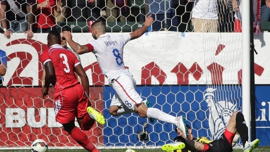 United States' Clint Dempsey, center, moves the ball past Panama goalie Jaime Penedo, right, to score during the first half of a friendly soccer match, Sunday, Feb. 8, 2015, in Carson, Calif. (AP Photo/Jae C. Hong)
