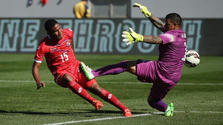 United States goalie Nick Rimando, right, stops a shot by Panama's Eric Davis during the first half of a friendly soccer match, Sunday, Feb. 8, 2015, in Carson, Calif. (AP Photo/Jae C. Hong)