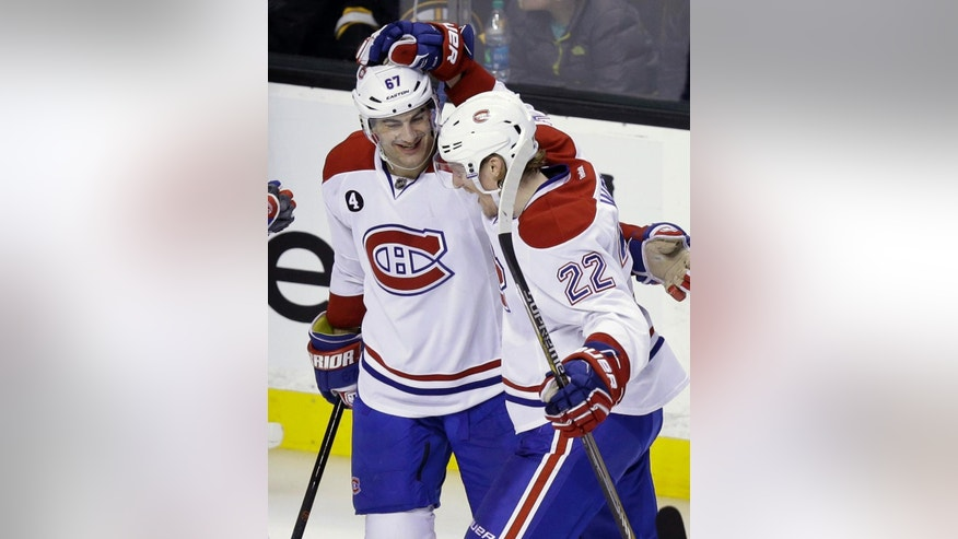 Montreal Canadiens left wing Max Pacioretty, left, celebrates with teammate right wing Dale Weise (22) after Pacioretty scored in the third period of an NHL hockey game, Sunday, Feb. 8, 2015, in Boston. The Canadiens defeated the Bruins 3-1. (AP Photo/Steven Senne)