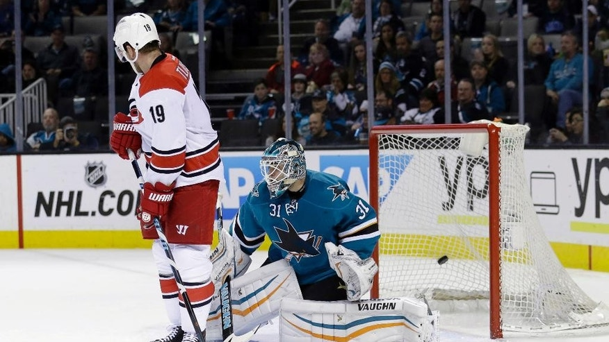 San Jose Sharks goalie Antti Niemi, right, is beaten for a goal on a shot by Carolina Hurricanes' Elias Lindholm, not seen, as left wing Jiri Tlusty watches during the second period of an NHL hockey game Saturday, Feb. 7, 2015, in San Jose, Calif. (AP Photo/Marcio Jose Sanchez)