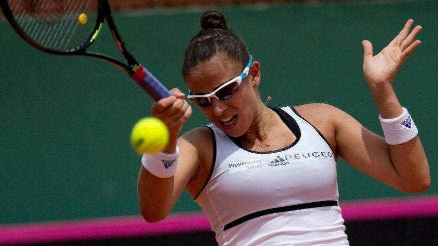 Paula Ormaechea of Argentina returns a ball against Coco Vandeweghe of the United States during the women's singles match at the Fed Cup in Buenos Aires, Argentina, Sunday, Feb. 8, 2015. Ormaechea  won the match  6-4 6-4. (AP Photo/Rodrigo Abd)