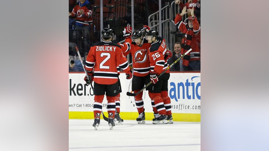 New Jersey Devils defenseman Marek Zidlicky (2), of the Czech Republic, Martin Havlat (9), of the Czech Republic, celebrate a goal by left wing Patrik Elias, (26), of the Czech Republic, during the first period of an NHL hockey game against the Edmonton Oilers, Monday, Feb. 9, 2015, in Newark, N.J. (AP Photo/Mel Evans)