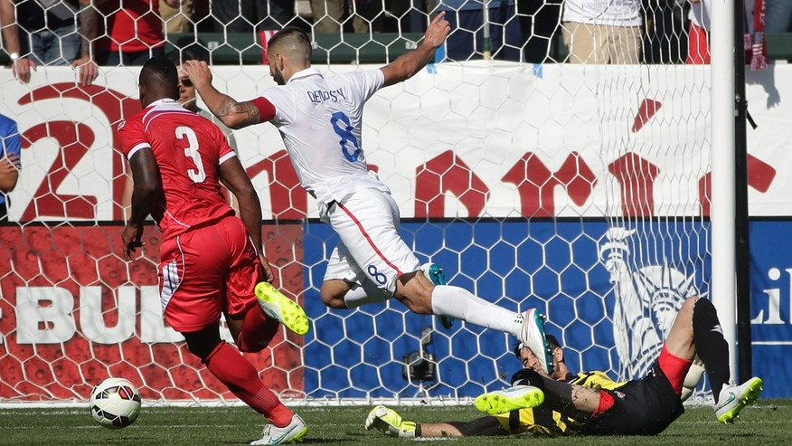 United Statesâ Clint Dempsey, center, moves the ball past Panama goalie Jaime Penedo, right, to score during the first half of a friendly soccer match, Sunday, Feb. 8, 2015, in Carson, Calif. (AP Photo/Jae C. Hong)