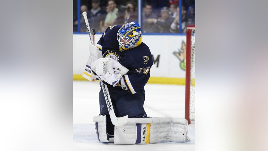 St. Louis Blues goalie Jake Allen (34) makes a save in the first period of an NHL hockey game against the Arizona Coyotes, Tuesday, Feb. 10, 2015, in St. Louis. (AP Photo/Tom Gannam)