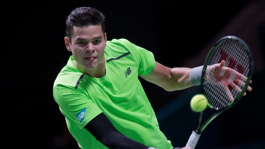 Canada's Milos Raonic returns the ball to Russia's Andrey Kuznetsov during their first round match of the 42nd ABN AMRO world tennis tournament at Ahoy Arena in Rotterdam, Netherlands, Tuesday, Feb. 10, 2015. Raonic won in three sets 6-7, 6-1, 7-5. (AP Photo/Peter Dejong)