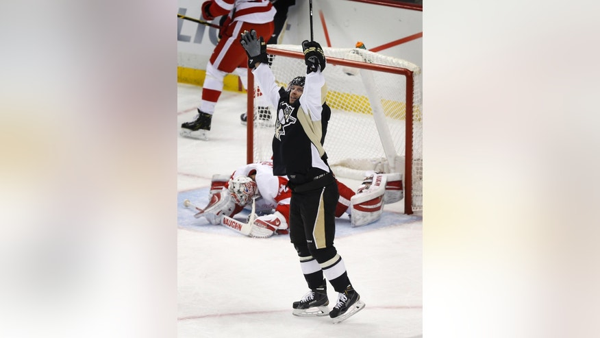 Pittsburgh Penguins' Blake Comeau celebrates after scoring on Detroit Red Wings goalie Petr Mrazek during the first period of an NHL hockey game, Wednesday, Feb. 11, 2015, in Pittsburgh. (AP Photo/Keith Srakocic)