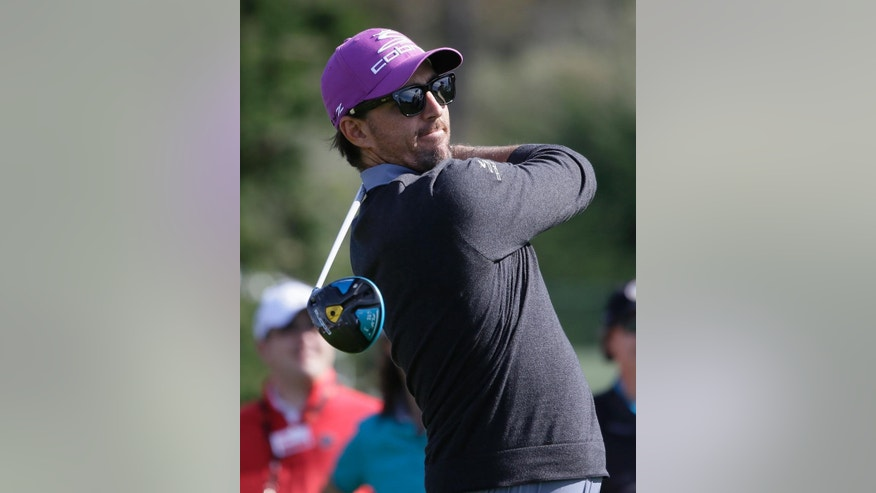 Musician Jake Owen follows his drive from the third tee of the Pebble Beach Golf Links during the celebrity challenge event of the AT&T Pebble Beach National Pro-Am golf tournament Wednesday, Feb. 11, 2015, in Pebble Beach, Calif. (AP Photo/Eric Risberg)