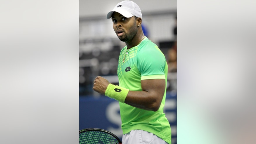 Donald Young celebrates a point during his tennis match against Denis Kudla at the Memphis Open, Thursday, Feb. 12, 2015 in Memphis, Tenn. (AP Photo/The Commercial Appeal, Nikki Boertman)