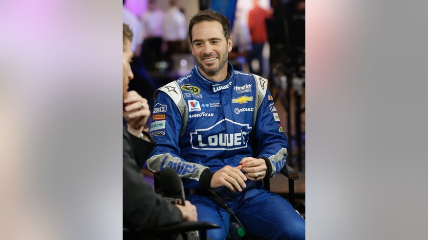 Jimmie Johnson takes part in an interview during NASCAR media day at Daytona International Speedway, Thursday, Feb. 12, 2015, in Daytona Beach, Fla. (AP Photo/John Raoux)