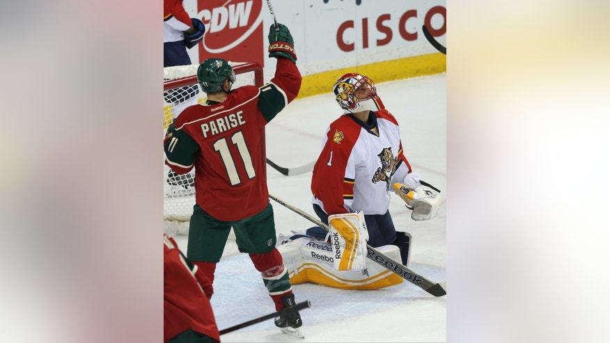 Minnesota Wild's Zach Parise, left, celebrates a goal by Jason Pominville off Florida Panthers goalie Roberto Luongo, right, in the first period of an NHL hockey game, Thursday, Feb. 12, 2015, in St. Paul, Minn. (AP Photo/Jim Mone)