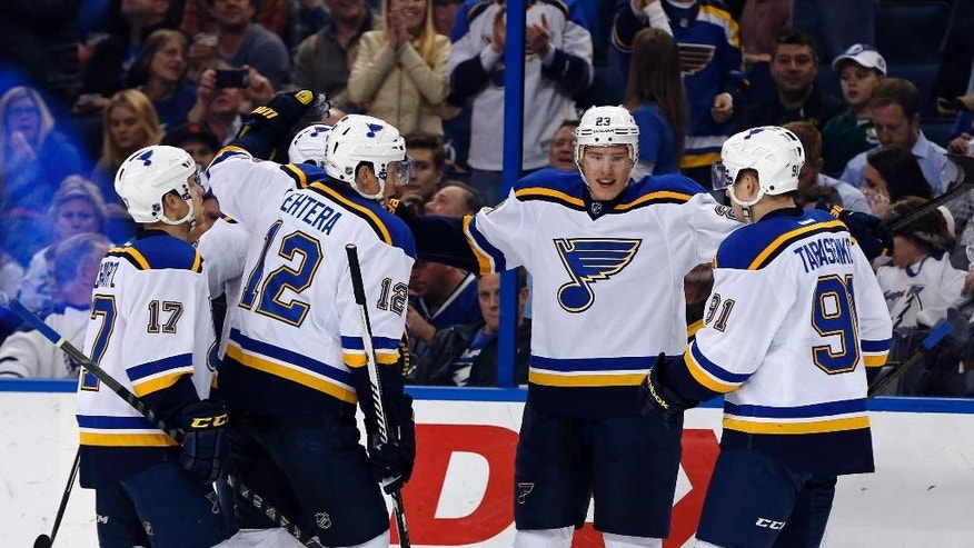 St. Louis Blues' Dmitrij Jaskin, of Russia, celebrates his goal with teammates, including Jaden Schwartz (17); Jori Lehtera (12), of Finland; and Vladimir Tarasenko (91), of Russia, during the first period of an NHL hockey game against the Tampa Bay Lightning on Thursday, Feb. 12, 2015, in Tampa, Fla. (AP Photo/Mike Carlson)