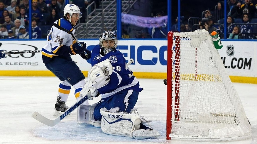 St. Louis Blues' T.J. Oshie scores past Tampa Bay Lightning goalie Ben Bishop during the first period of an NHL hockey game Thursday, Feb. 12, 2015, in Tampa, Fla. (AP Photo/Mike Carlson)