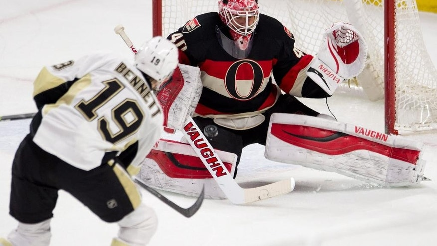 Pittsburgh Penguins right wing Beau Bennett shoots on Ottawa Senators goalie Robin Lehner during the first period on an NHL hockey game, Thursday, Feb. 12, 2015 in Ottawa, Ontario.  (AP Photo/Canadian Press, Adrian Wyld)
