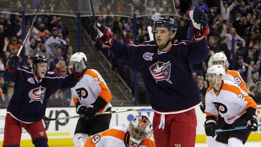 Columbus Blue Jackets' Artem Anisimov, right, of Russia, celebrates his game-winning goal against the Philadelphia Flyers during overtime of an NHL hockey game Friday, Feb. 13, 2015, in Columbus, Ohio. The Blue Jackets won 4-3. (AP Photo/Jay LaPrete)