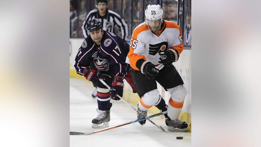 Philadelphia Flyers' Nick Schultz, right, loses his stick as Columbus Blue Jackets' Brandon Dubinsky tries to control the puck during the first period of an NHL hockey game Friday, Feb. 13, 2015, in Columbus, Ohio. (AP Photo/Jay LaPrete)