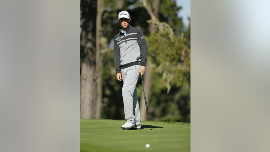 Matt Jones reacts after missing a birdie putt on the 10th green of the Spyglass Hill Golf Course during the second round of the AT&T Pebble Beach National Pro-Am golf tournament Friday, Feb. 13, 2015, in Pebble Beach, Calif. (AP Photo/Eric Risberg)